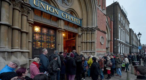 Fans queue to enter the David Bowie tribute concert