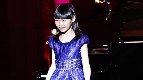 Nine-year-old pianist Charlotte Kwok, from Llanharan, who is a member of the Royal Welsh College of Music and Drama's junior conservatoire, performs at a gala concert for the Royal Welsh College of Music and Drama at Buckingham Palace, London