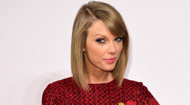 Taylor Swift is fighting it out with rapper Kendrick Lamar for Grammy honours