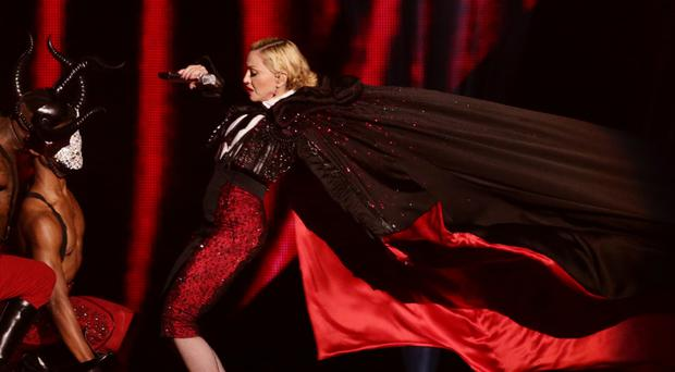 Madonna takes a tumble down stairs while performing on stage, during the 2015 Brit Awards