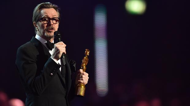 Gary Oldman collects the Brits icon award for David Bowie