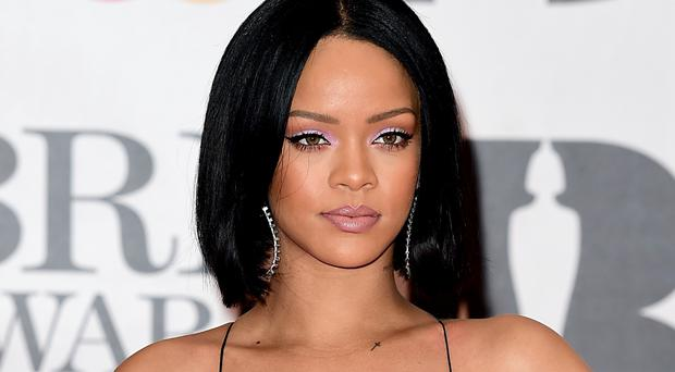 Rihanna's Work is just 8,000 combined sales behind as of Monday