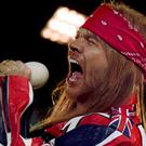 Axl Rose, of Guns N' Roses, will tour with AC/DC