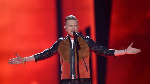 Ireland's Nicky Byrne performs the song 'Sunlight'.
