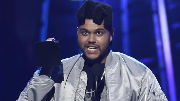 The Weeknd accepts the top 100 artist award at the Billboard Music Awards (Invision/AP)