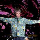 Ian Brown of The Stone Roses performs in front of fans