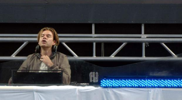 British DJ Paul Oakenfold plays before the Madonna concert, at Slane Castle, Co Meath, Republic of Ireland