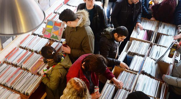File photo dated 16/04/16 of shoppers in the Love Vinyl record shop in Hoxton, east London, as global sales of vinyl records will break through the one billion US dollar mark (£820 million) for the first time this century, a report said.