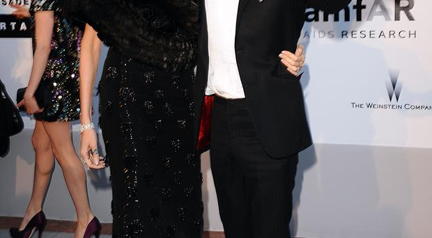 L'wren Scott and Mick Jagger arriving for the amfAR Cinema Against AIDS 2010 fundraiser at the Hotel Du Cap, Eden Roc, Cap D'Antibes during the Cannes Film Festival