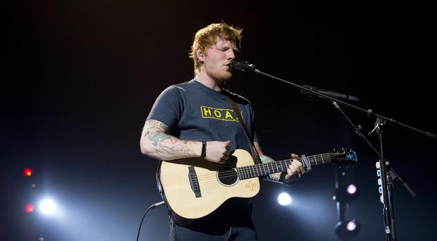 Ed Sheeran performs on stage (PA)
