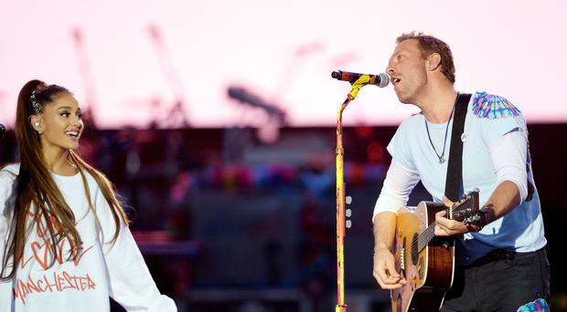 Ariana Grande and Chris Martin performing during the One Love Manchester benefit concert for the victims of the Manchester Arena terror attack at Emirates Old Trafford, Greater Manchester.
