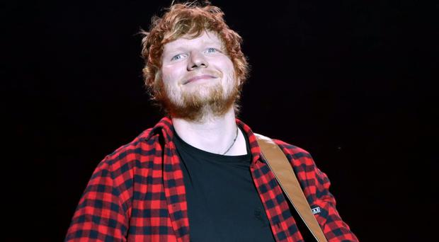 Ed Sheeran remains at number one in the UK charts (Yui Mok/PA)