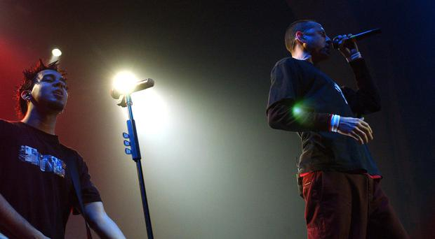 Mike Shinoda (left) and Chester Bennington of Linkin Park performing on stage at the Brixton Academy in London in 2003 (PA)