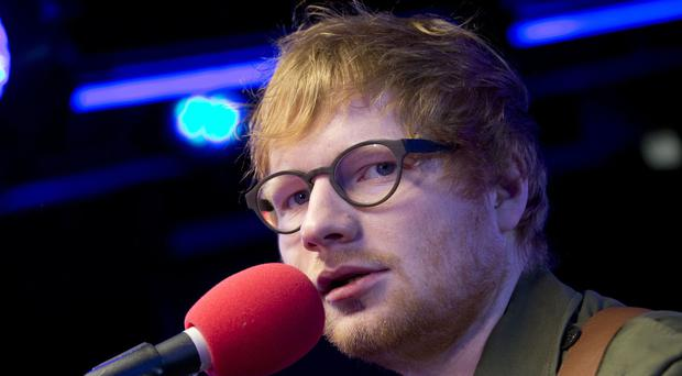 Ed Sheeran and Ariana Grande are both up for best artist (Isabel Infantes/PA)