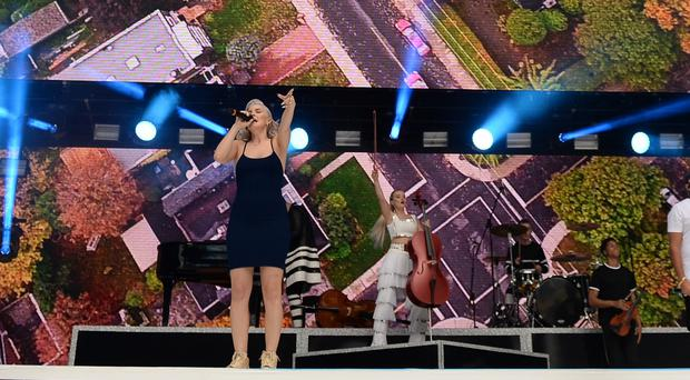 Clean Bandit had to do a DJ set because of the weather( Chris J Ratcliffe/PA)