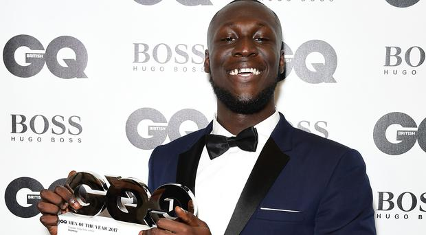 Stormzy with his Copper Dog Whiskey Solo Artist award during the GQ Men of the Year Awards