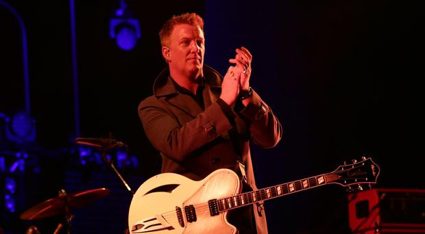 Josh Homme of Queens of the Stone Age at Reading Festival in 2014. (Yui Mok/PA)