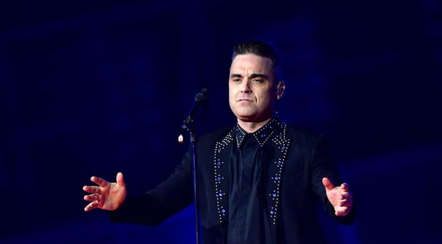 Robbie Williams performs on stage at the Brit Awards (Dominic Lipinski/PA)
