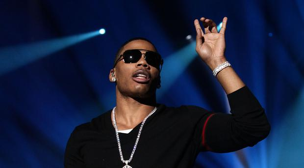Nelly denies raping the woman on his tour bus