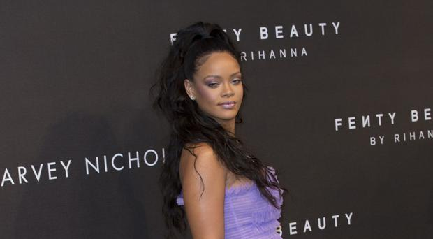 Rihanna was hailed a lucky charm by Arsenal's Mesut Ozil (Isabel Infantes/PA)
