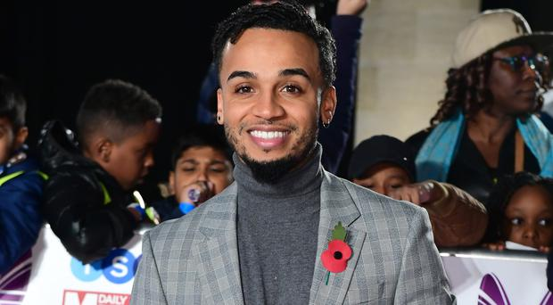 Aston Merrygold's newborn son wears a cute romper to celebrate the star's 30th (Ian West/PA)