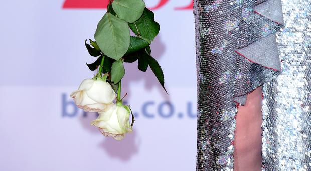 Paloma Faith carrying white roses