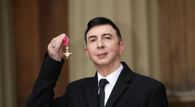 Soft Cell frontman Marc Almond holds his OBE following an investiture ceremony at Buckingham Palace (Yui Mok/PA)