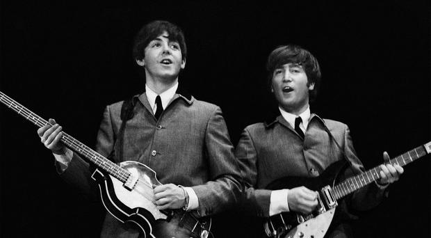 Paul McCartney and John Lennon in one of a series of shots of The Beatles' first US concert tour (Mike Mitchell/Omega Auctions)