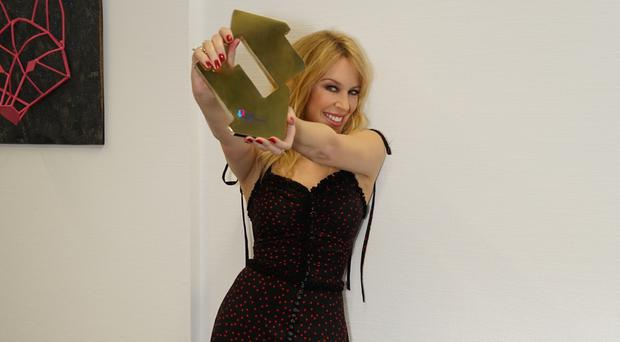 Kylie Minogue has her sixth number one album (OfficialCharts.com / Christian Vermaak)