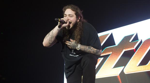 Rapper Post Malone lands first UK number one album (Owen Sweeney/Invision/AP)
