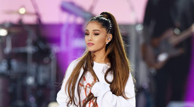 Ariana Grande has revealed her tattoo tribute to the victims of the Manchester Arena bombing (Dave Hogan for One Love Manchester/PA)