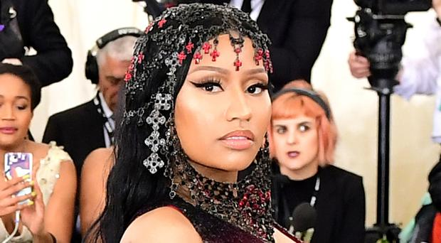 Nicki Minaj told Elle magazine that knowing she does not need to be with someone to live her life, or for her career, is empowering (Ian West/PA)