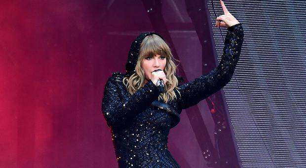 Taylor Swift performing on stage at Wembley Stadium (Ian West/PA Images)