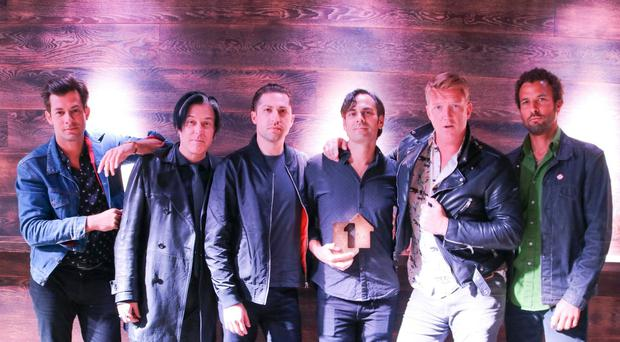 Queens Of The Stone Age played to huge crowds at Finsbury Park (Official Charts Company)
