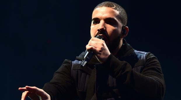 Drake is edging a close race with Florence and the Machine for number one on the albums chart (Ian West/PA)