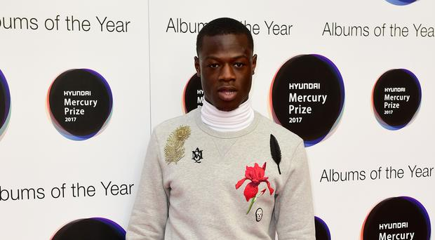 J Hus has been charged with knife possession (Ian West/PA)