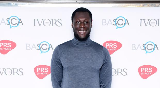 Stormzy has shared a photo throwback to Adele's Titanic 30th birthday celebrations.