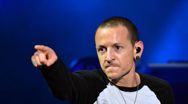 Chester Bennington's Linkin Park bandmates have paid tribute to their former lead singer on the anniversary of his death (Lewis Stickley/PA)