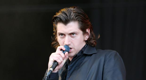 Arctic Monkeys frontman Alex Turner shows off shock new look (Jane Barlow/PA)