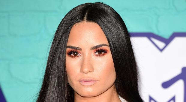 Demi Lovato is awake and with her family after earlier being taken to hospital (an West/PA Wire)