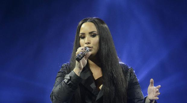 A planned performance by Demi Lovato has been cancelled after she was taken to hospital (John Linton/PA)