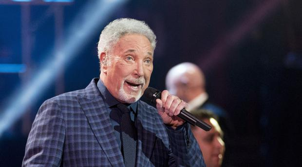 Sir Tom Jones 'feeling much better' and will return to the stage (David Mirzoeff/PA)