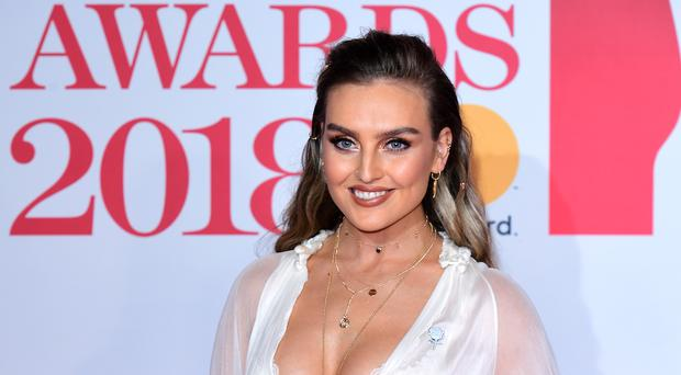 Perrie Edwards has has an operation on her oesophagus (Ian West/PA)
