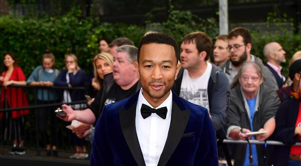 John Legend has said he was shocked when Kanye West shared their text messages about Donald Trump (Ian West/PA)