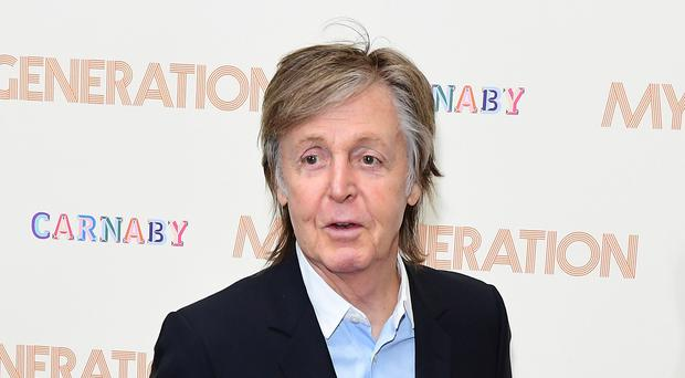 Sir Paul McCartney has revealed a little of what life was life in the Beatles (Ian West/PA)
