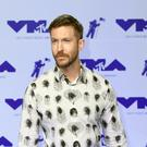 Calvin Harris remains at number one with Sam Smith (PA)