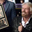 Richard Branson has been honoured with a star on the Hollywood Walk of Fame (Photo by Chris Pizzello/Invision/AP)
