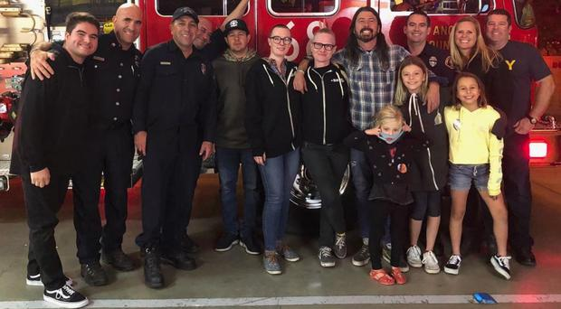 Dave Grohl stands with firefighters (instagram.com/firestation68)