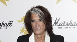 Joe Perry of Aerosmith, who is 'doing well' after being taken to hospital with breath problems (Yui Mok/PA)