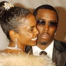 Sean 'P. Diddy' Combs and Kim Porter at his 35th Birthday Ball (Rich Lee/PA)